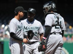 Marlins pitcher Hanley Ramirez meets on the mound against the Washington Nationals in Washington