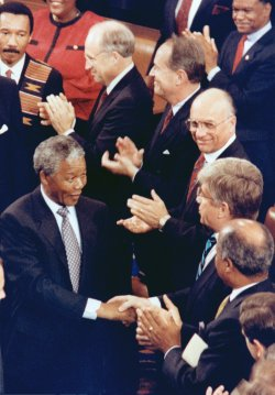 Nelson Mandela shaking hands with Jack Kemp at the Capitol