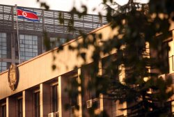 North Korea's flag flies over its embassy in Beijing