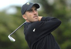 Geoff Ogilvy watches his drive during the first round of the 2009 Presidents Cup in San Francisco