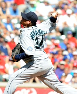 Mariners pitcher Hernandez throws against the Rangers