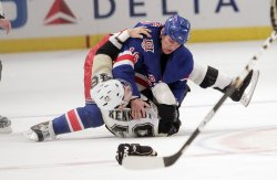 Pittsburgh Penguins Tyler Kennedy and New York Rangers Sean Avery fight on the ice at Madison Square Garden in New York