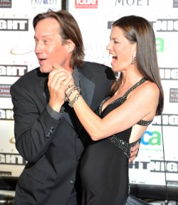 Kevin Sorbo and Sam Jenkins share a light moment at Celebrity Fight Night in Arizona