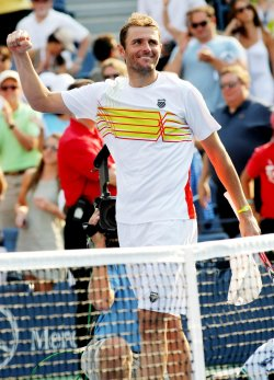 Mardy Fish defeats Nikolay Davydenko in second-round action at the U.S. Open in New York