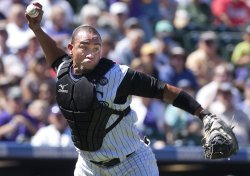 Rockies Olivo Throws Out Reds Phillips in Denver