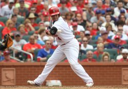 St. Louis Cardinals Yadier Molina is hit by pitch
