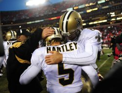 Saints' kicker Garrett Hartley celebrates in Washington