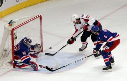 Washington Capitals Mike Knuble gets the puck past New York Rangers goalie Henrik Lundqvist at Madison Square Garden in New York