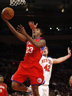 Philadelphia 76ers Louis Williams drives to the basket in the third quarter past the New York Knicks David Lee at Madison Square Garden in New York City