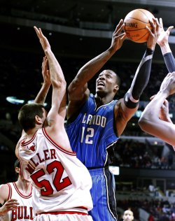Magic's Howard shoots as Bulls' Miller defends in Chicago