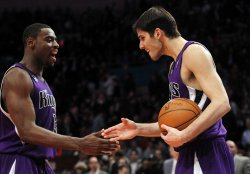 Sacramento Kings Tyreke Evans and Omir Casspi (R) react at Madison Square Garden