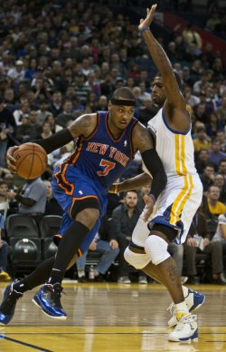 New York Knicks Carmelo Anthony drives on Golden State Warriors Dorell Wright in Oakland, California