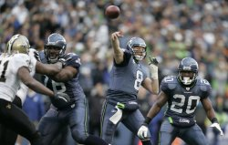 Seattle Seahawks quarterback Matt Hasselbeck passes against the New Orleans Saints in Seattle.