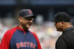 Boston Red Sox manager Terry Francona talks with umpire Mark Carlson against the Chicago White Sox in Chicago
