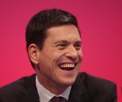 Britain's Foreign Secretary David Miliband laughing at the Labour Party Conference 2009.