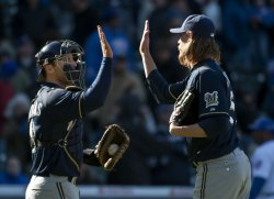 Brewers' Kottaras and Axford Celebrate Win Over Cubs in Chicago
