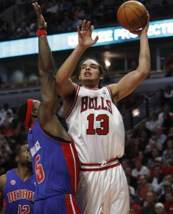 Bulls' Noah shoots over Pistons' Wallace in Chicago