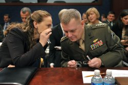 Vice Chairman of the Joint Chiefs of Staff Gen. James Cartwright talk to Defense Undersecretary for Policy Michele Flournoy prior to testifying on the missile defense shield in Washington