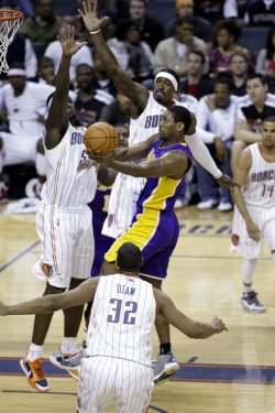 Los Angeles Lakers forward Ron Artest shoots against the Charlotte Bobcats