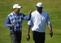 Tiger Woods talks to Michael Jordan during a practice round prior to the 2009 Presidents Cup in San Francisco