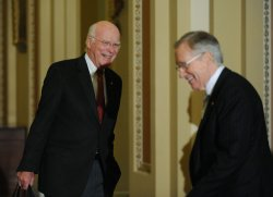 Senate Majority Leader Reid and Sen. Leahy laugh after Senate passed cloture vote on healthcare legislation in Washington