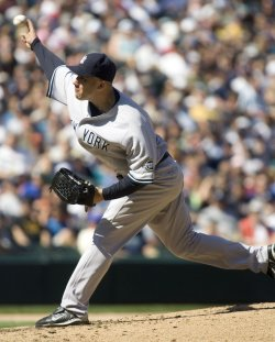 New York Yankees reliever Alfredo Aceves pitches against the Seattle Mariners in the sixth inning at SAFECO Field in Seattle.