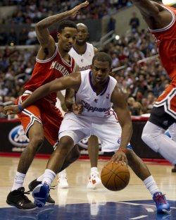 Los Angeles Clippers' Chris Paul drives by Milwaukee Bucks Brandon Jennings