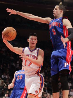 New York Knicks Jeremy Lin passes the ball at Madison Square Garden in New York