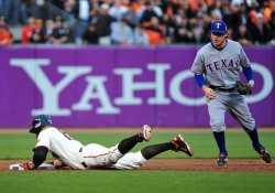 Giants' Cody Ross slides into second during game 2 of the World Series in San Francisco