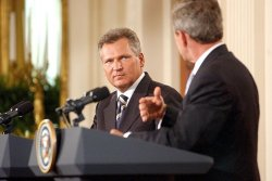 President George W. Bush meets with President Aleksander Kwasniewski of Poland