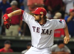 Rangers C.J. Wilson pitches to the St. Louis Cardinals in game 5 of the World Series in Texas