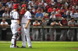 Rangers pitcher C.J. Wilson talks to catcher Mike Napoli during game 5 of the World Series in Texas