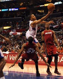 Eric Gordon shoots over Miami Heat