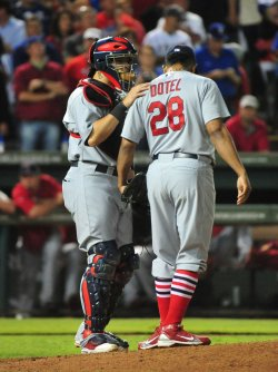 Cardinals catcher Yadier Molina talks to Cardinals pitcher Octavio Dotel during game 5 of the World Series in Texas