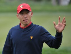 Anthony Kim acknowledges the gallery during the 2009 Presidents Cup in San Francisco