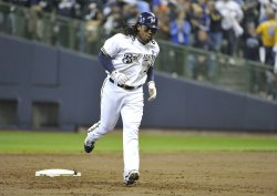 Brewers' second baseman Rickie Weeks connects for a solo homerun during game 6 of NLCS in Milwaukee, Wisconsin