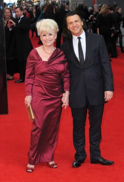 "Barbara Windsor and Scott Mitchell attend ""The Olivier Awards 2012"" in London"