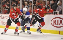 Blackhawks' Bolland, Hjalmarsson and Blues' Sobotka go for puck in Chicago