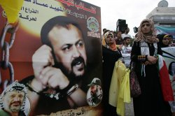Palestinians protest supports prisoners on a hunger strike in Israeli jails