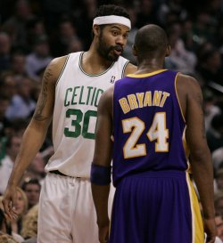 Lakers Bryant chats with Celtics Wallace in Boston, MA.