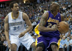 Lakers Bryant Looks for Shot Against Nuggets Miller During the NBA Western Conference Playoffs First Round Game Six in Denver