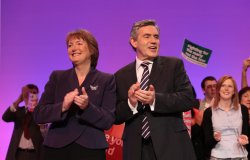 Gordon Brown and Harriet Harman laugh on stage on the final day of the Labour Party Conference 2009.