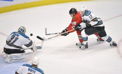 Blackhawks Kane tries to score on Sharks Niemi in Chicago
