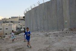 Palestinian Children Near Israeli Separation Wall In Abu Dis,West Bank