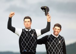 Fisher and Harrington celebrate fourball win on the third day of Ryder Cup.