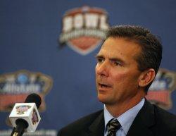 University of Florida Coach Urban Meyer speaks with the media