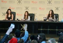 Kim Kardashian, Khloe Kardashian Odom and Kourtney Kardashian attend a photo call in London