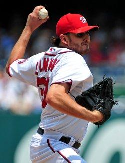 Washington Nationals pitcher John Lannan pitches in Washington.