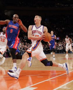 Detroit Pistons Damien Wilkins watches New York Knicks Jeremy Lin at Madison Square Garden in New York
