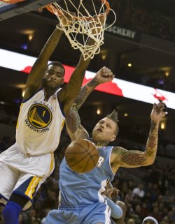 Warriors Dorell Wright slams home two over Nuggets Chris Andersen in Oakland, California